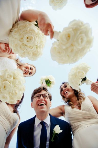 Groomsmen with bridesmaids and flowers-New York City Wedding Photographers