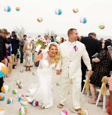 Bride and Groom With Beach Ball Toss Post Beach Ceremony