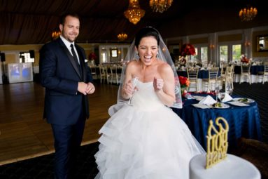 Bride and Groom excited about the wedding cake